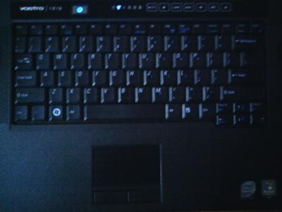 Keyboard with speakers on side and touchpad